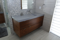 Thumb vanity  contemporary style  walnut  medium color  frameless construction  banded door  floating  off center sink