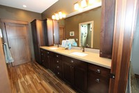 Thumb vanity  craftsman style  hard maple  dark color  recessed panel  double sink  towers  toppers  linen  full overlay