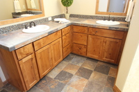 Thumb vanity  craftsman style  knotty alder  medium color  recessed panel  double sinks  master bath  standard overlay