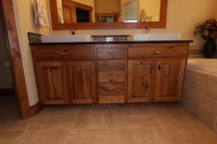 Thumb vanity  rustic style  knotty hickory   medium color  raised panel  double sink  standard overlay