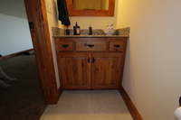 Thumb vanity  rustic style  knotty hickory  medium color  raised panel  single sink  standard overlay  2