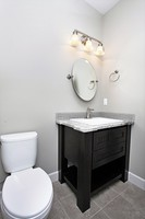 Thumb vanity  shaker style  painted  wainscot panel  powder  single sink  open shelf  posts  black paint