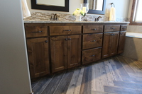 Thumb vanity  traditional style  knotty alder  dark color  recessed panel  double sinks  standard overlay