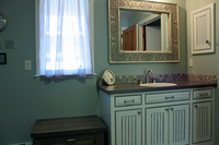 Thumb vanity  traditional style  painted with glaze  wainscot panel  flush mount  medicine cabinet  arched toekick  contrast bench seat