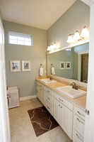 Thumb vanity  traditional style  painted  raised panel  double sinks  double sinks  banks of 3 drawers  standard overlay