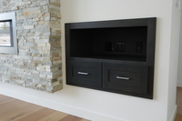 Thumb great room  contemporary style  clear alder  dark color  entertainment center  built in  slip in  fireplace area