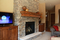 Thumb great room  craftsman style  knotty alder  medium color  fireplace mantle  base cabinets with wood tops  entertainment center  standard overlay