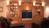Thumb great room  traditional style  cherry  raised panel  medium color with green glaze  bookcases  entertainment center  built ins  lights on cabinets  standard overlay