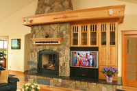 Thumb great room  traditional style  red birch  light color  raised panel  entertainment center  off center fireplace  mantel  carved onlays. craftsman glass grid doors  standard overlay