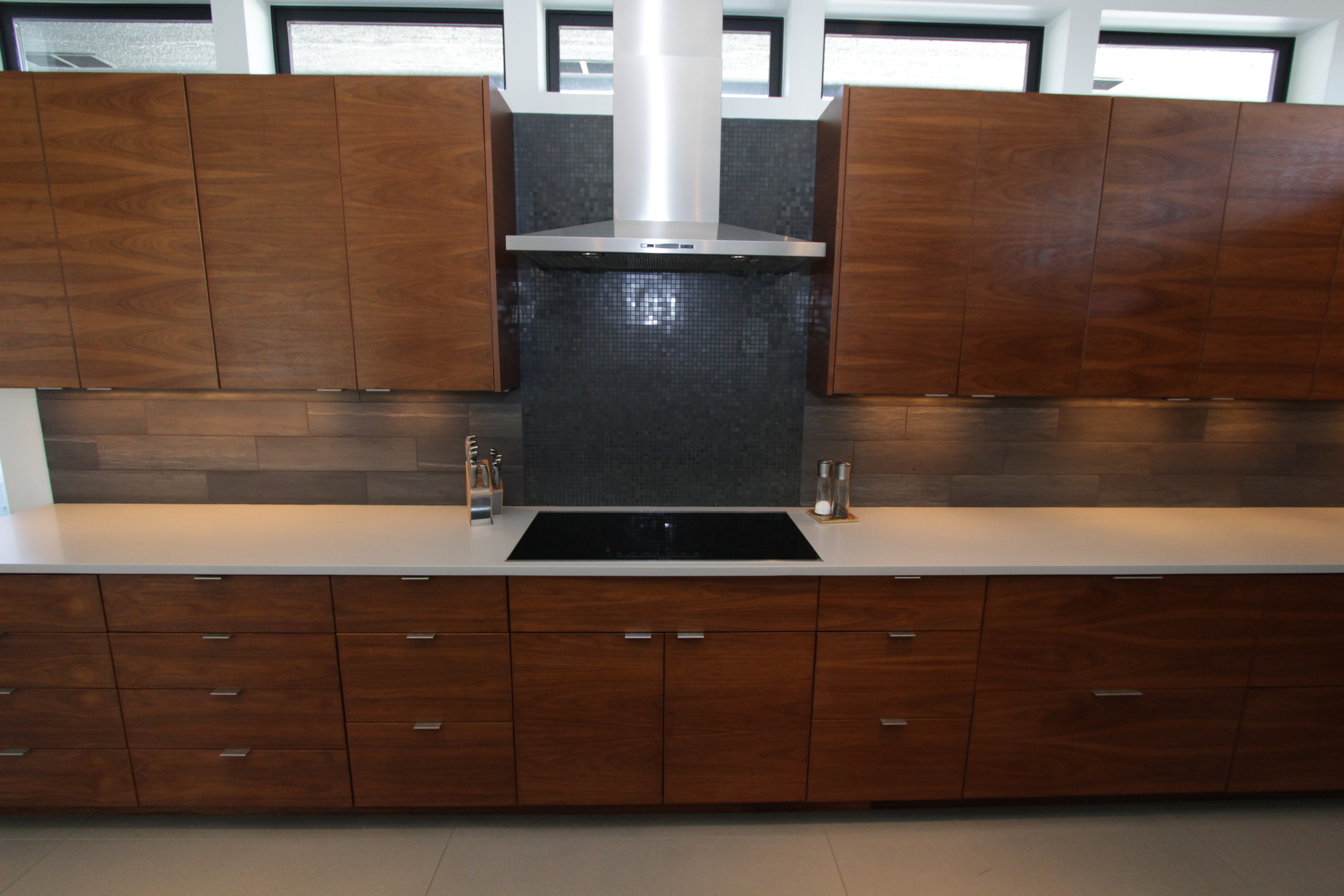 Thumb Kitchen Contemporary Style Walnut Medium Color Banded Door Frameless Construction Chimney Hood Bank Of Drawers
