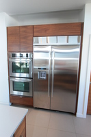 Thumb kitchen  contemporary style  walnut  medium color  banded door  frameless construction  lift up door above the refrigerator  horizontal grain match