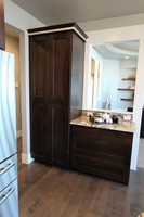 Thumb kitchen  contemporary style  walnut  recessed panel  coffee bar area  pantry cabinet  full overlay  bank of drawers  5 piece drawer fronts