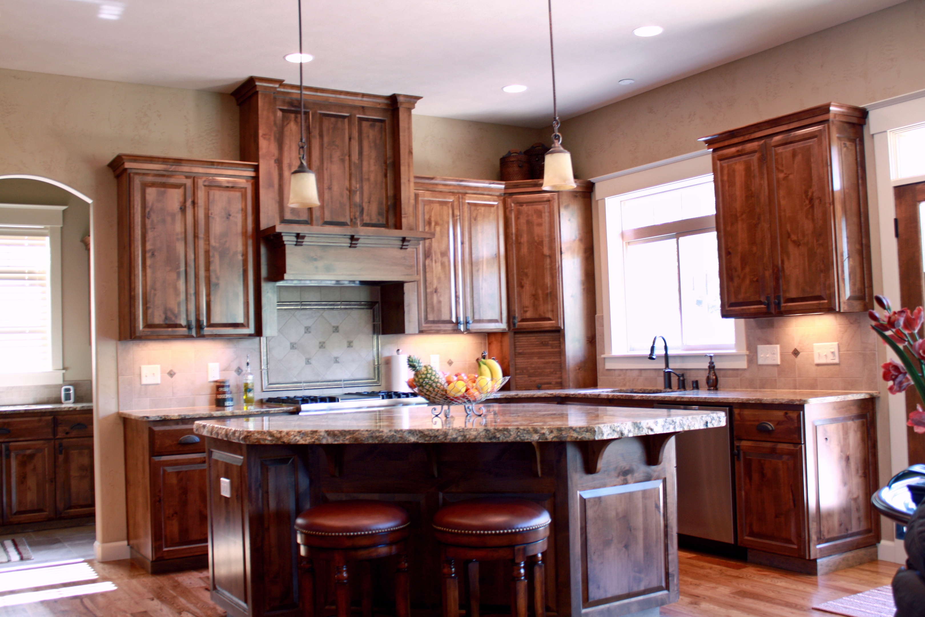 affordable custom cabinets showroom thumb kitchen craftsman style knotty alder dark color island overhang with standard bar supports appliance garage