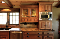 Thumb kitchen  craftsman style  quartersawn oak  medium color  flush mount  medium color  glass grid doors  diagonal corner cabinets  micro in upper cabinet  front dovetail drawers  bevel drawer fronts