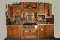 Thumb kitchen  craftsman style  quartersawn oak  medium color  raised panel  flush mount  wood hood  praire grid glass doors  shaker step feet  stemware holders  front dovetail drawers