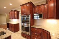 Thumb kitchen  traditional style  cherry  dark color  raised panel  micro in upper  staggered heights  double oven cabinet