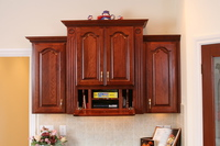 Thumb kitchen  traditional style  cherry  raised panel with arch  cherry color  organizer with tip down front  flutes and rosettes  braided crown  staggered heights