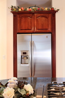 Thumb kitchen  traditional style  cherry  raised panel with arch  cherry color  refrigerator with flutes and rosettes