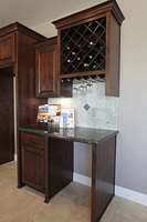 Thumb kitchen  traditional style  knotty alder  dark color  raised panel door  wine rack  open area  standard overlay