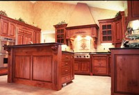 Thumb kitchen  traditional style  knotty cherry  cherry color  glazed  raised panel  flush mount  angled wood hood  stucco top  raised bar neck with panel back of island  flutes  carved corbels