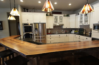 Thumb kitchen  traditional style  painted  recessed panel doors  accent color  black or grey  island  wood top  full overlay