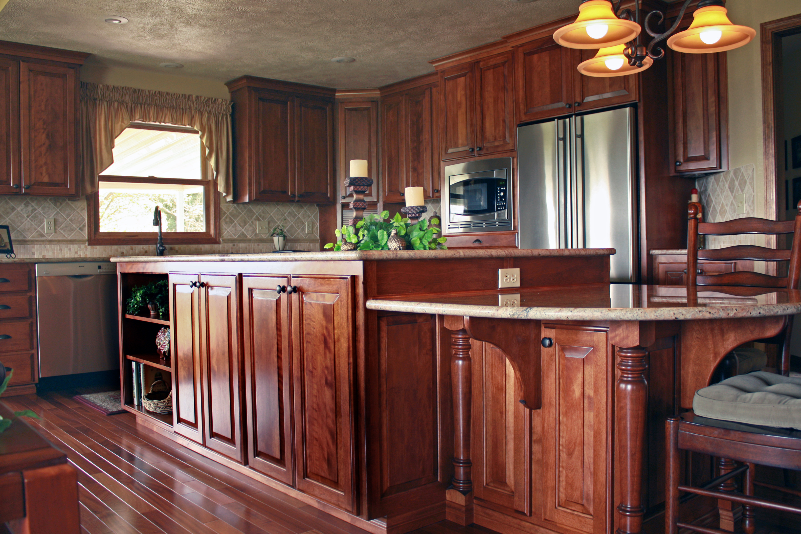 Home Furniture Kitchen Island Panels affordable custom cabinets showroom thumb kitchen traditional style red birch dark raised panel island with posts and bar supports