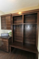 Thumb misc  contemporary style  quartersawn walnut  dark color  banded door  cubbies  lockers  coat hooks  drop off station  bench  full overlay