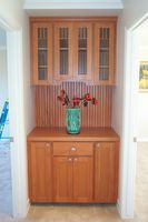 Thumb misc  craftsman style  cherry  light color  recessed panel  craftsman glass grid  wainscot backsplash and back  hutch  buffet  standard overlay